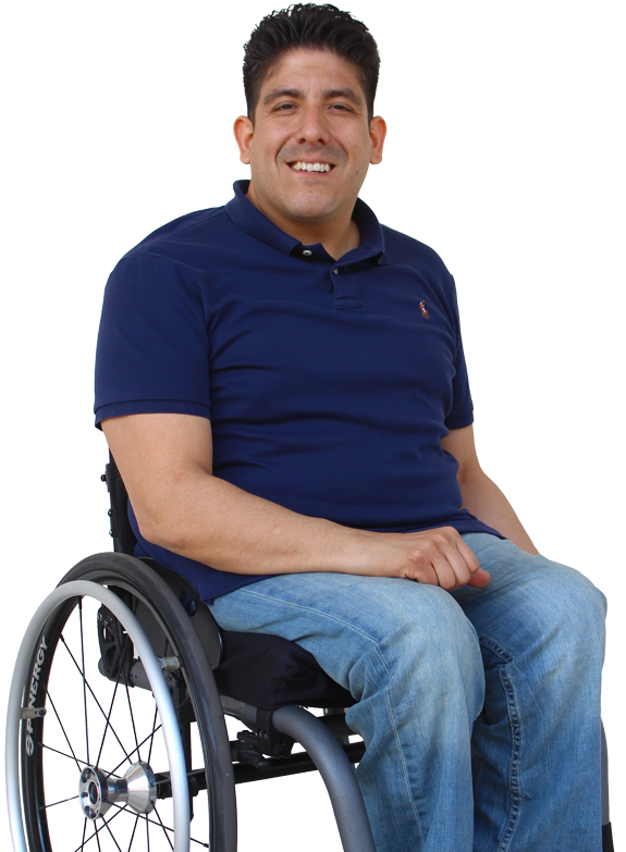 Photo of a young man sitting in a wheelchair.